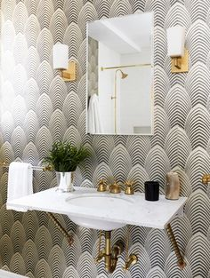 70's black and white graphic wallpaper, guest bath ideas, acrylic and gold towel rod, gold sconces