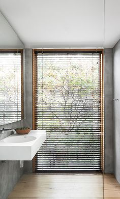 Modern bathroom huge window and blind