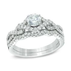 This ring showcases a 1/2 CT. diamond center stone that stands tall atop the twisting diamond-lined shank.