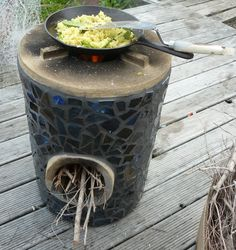 rocket stove mass heater | The rocket stove heating leftover ginger-garlic rice with freshly ...