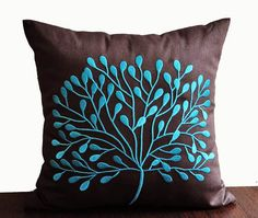 Use embroidery to add colour to an uninspired throw pillow