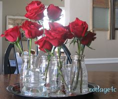 Simple valentine's centerpiece.  Could make it more romantic by adding tulle and small candles?