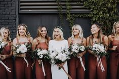 Summer Wedding Dresses These bridesmaid are setting trends in their chic burnt orange jumpers Burnt Orange Bridesmaid Dresses, Burnt Orange Weddings, Winter Bridesmaid Dresses, Winter Bridesmaids, Burnt Orange Dress, Wedding Bridesmaids, Lilac Wedding, Summer Wedding, Chic Wedding