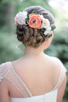 Prettiest updo adorned with beautiful blooms!