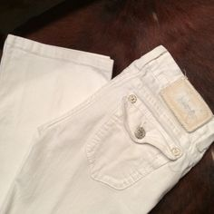 "MEK white bootcut jeans MEK white denim bootcut jeans.  27"" waste with 31"" inseam.  White stitching and silver buttons and studs on the pockets. Came with distressing on the legs. Fit and look great with wedges! MEK Jeans Boot Cut"