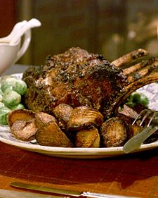 Roast beef is classic British fare. It's the centerpiece of a traditional Sunday dinner, and the hearty main course for a holiday celebration. Chef Anne Willan has drawn on her own family's techniques for cooking and serving a standing rib roast for this recipe, which is served with roast potatoes and Yorkshire pudding.