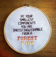 At your smallest components you are indistinguishable from a forest fire - Welcome to Night Vale embroidery (cross stitch and back stitch)  (not mounted or anything yet, hence the cloth looking a bit weird. It's just tucked in behind)