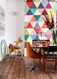 .Colourful geometric wall. Wonder if it's hard to build out a temporary wall to create a temporary fireplace home in an apt. Very thin and would create two little alcoves on the sides.