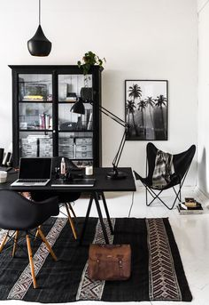 Black and white home office decor - Loop table by Hay, Vitra Eames chairs and Tom Dixon lamp | Photo by Stella Harasek | www.stellaharasek.com