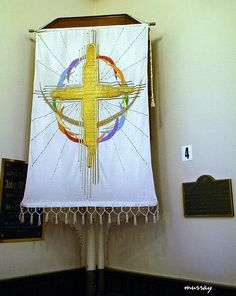 The appliqued colors around the cross are wonderful.
