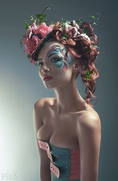 Blue corset with pink closures, artistic makeup and hair...