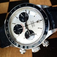 Yup, definitely becoming a Daytona Paul Newman fan. This dial face is an epic design, clean white / black and a just a touch of red.   Sooo balanced, so clean, so nice.