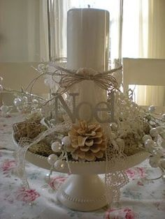 like this Christmas decor with the hurricane over the candle on top of a cake plate with all  the pretty goodies around it