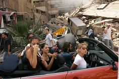 """photographer Spencer Platt, World Press Photo of the Year (2006), from his series on Lebanon. .. """"Affluent Lebanese drive down the street to look at a destroyed neighborhood August 15, 2006 in southern Beirut, Lebanon. As the United Nations brokered cease fire between Israel and Hezbollah enters its first day, thousands of Lebanese returned to their homes and villages."""""""