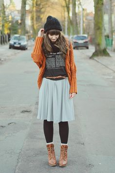 orange cardi, blue skirt, rock shirt