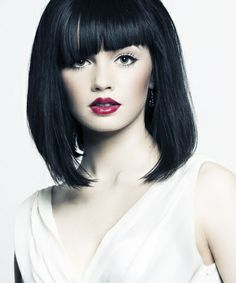 Wow...ya gotta love this striking look with short hair. Great photo too. Very nice.