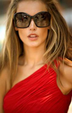 Red dress pair of dark oversized sunglasses