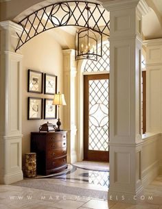 Love this entry decor details and archway Marc Rutenberg Homes