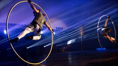 While masterfully controlling his balance, an acrobat rotates on the floor in a Cyr Wheel ring that becomes an extension of his body. The act is full of dyn Circus Acts, Acting, Floor, Pure Products, Birthday, Party, Boden, Fiesta Party, Parties