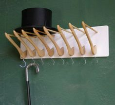 Use old hangers to create your own coat rack!