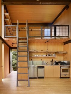 tiny home interior with metal railing and ladder for loft