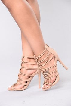 - Available in Taupe - Strappy Front - Metallic Gold Accents - Back Zipper Closure - Faux Suede - 4 1/4 Inch Heel