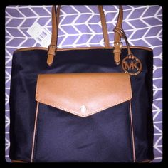 Michael Kors Jet Set Nylon Tote Never been used! Large Black and Tan nylon tote with gold hardware. Multiple pockets and 2 compartments makes this perfect for work or travel. Michael Kors Bags Totes