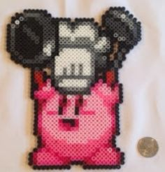 Cooking Kirby perler beads by Kaylin Grant