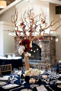 Fall Wedding Centerpieces 9 Stunning Fall Wedding Centerpiece Ideas for branch with burgundy flower and hanging glass floating candle goes well with navy blue table cover, diy wedding reception decorations<br> Branch Centerpieces, Rustic Wedding Centerpieces, Centerpiece Ideas, Centerpiece Flowers, Table Decorations, Flower Arrangements, Maroon Wedding, Floral Wedding, Wedding Flowers