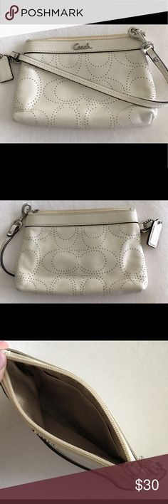EUC perforated ivory Coach wristlet Soft leather wristlet. Coach with perforated logo. Used for about 2 weeks and in excellent condition. Coach Bags Clutches & Wristlets