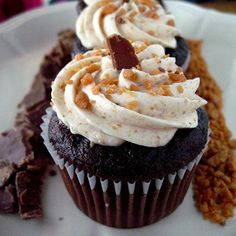 Dark Chocolate Cupcakes with Ganache Inside and Light Mocha Buttercream Icing with Butterfingers Imbedded