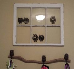 I painted owls on an old window, and screwed owl hooks on a log.