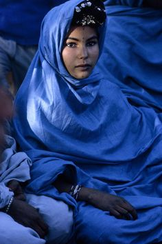 National Geographic: A nomadic Reguibat woman poses in traditional robes