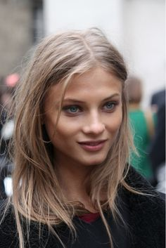Hair: Messy, mussed, layered, long, wispy, center part.