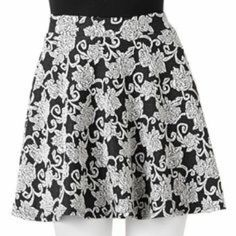 "Floral Skater Skirt Joe B Floral skater skirt. A very pretty skater skirt with an off white rose on black background pattern. This is a ""re-posh"", very lovely, but it's quite short on me. For reference, waist is approximately 25"" around (stretchy material so it's very comfortable when worn), and middle to the hem is 16"". A very versatile piece to add to your wardrobe. My loss is your gain! Joe B Skirts Circle & Skater"