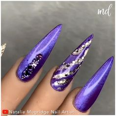 Find me a better combination than purple & golden! By @natmugnailartist