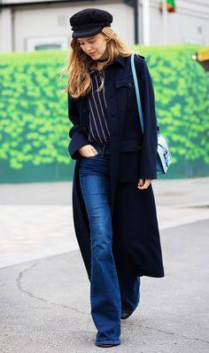 This Danish Stylist Has the Best Outfit Ideas via @WhoWhatWear Want instant cool girl vibes? This 70s-inspired outfit should do the trick. Pair a long coat with a striped shirt and flares. Finish it off with a cap.