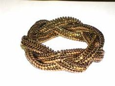 From BeadJeweledInc.com: Braided Ndebele Cuff    This textural cuff is created from triangel beads woven into a flat flexible braid that forms a gorgeaous cuff. This is a one day workshop for intermediate level beaders.