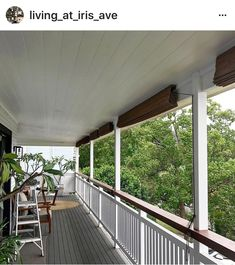 Balcony railing or balustrade with stained timber detail set against the white timber makes for a great beach or Hamptons style.