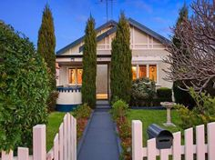 brick house with picket fence - Google Search