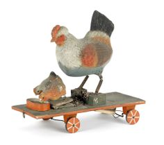 """Highly unusual German squeak toy on wheels, late 19th c., with a mother and two chicks feeding, 10 1/2"""" h., 11"""" w. Provenance: Collection of Elie Nadelman; Lincoln Kirsteins."""