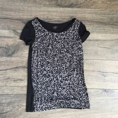 Ann Taylor Loft shirt Anne Taylor Loft shirt like new.  Leopard print grey and black shirt that you can dress up or dress down. LOFT Tops Tees - Short Sleeve