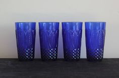 Set of four deep cobalt blue royal sapphire leaf pattern glass tumblers by Arcoroc France.  Dimensions: 3 1/8 wide across top, 5 7/8 tall  If youd
