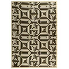 Add a pop of pattern to your living room or patio with this artfully crafted indoor/outdoor rug, showcasing a geometric motif in sand and black.