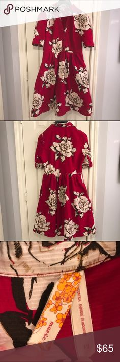 Anthropologie Maeve red floral fit and flare dress Anthropologie Maeve red floral flit and flare shirt dress. Top buttons. Lining in skirt is shown in last picture. Super cute, very well made dress. Size 12. Gently worn, no flaws except for care tag is starting to fall out from inside of skirt. Anthropologie Dresses