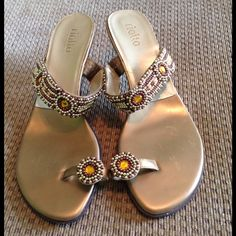 Rialto Beaded Kitten Heel Sandals 8.5 Gorgeous beading on these great vacation shoes!  Wear with shorts during the day and with your favorite maxi or mini dress at night!  Pre-loved condition, nicks in heel visible in photo.  Lots of life left! Rialto Shoes Sandals
