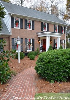 How To Hang Wreaths on Exterior Windows for Christmas Hanging Wreaths on Exterior Windows, Brick Walkway Christmas Wreaths For Windows, Christmas Window Decorations, Christmas House Lights, Christmas Porch, Wreaths In Windows, Merry Christmas, Christmas Planters, Antique Christmas, Primitive Christmas