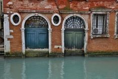size: Photographic Print: Old and Colorful Doorways and Windows in Venice, Italy by Darrell Gulin : Garden Architecture, Beautiful Architecture, Old Doors, Windows And Doors, Venice House, Venice Painting, Frames On Wall, Framed Wall, Venice Italy