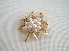 Vintage Trifari gold tone leaf brooch with faux pearls and small clear rhinestones