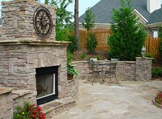 Large stone fireplaces work so well as a central feature outdoor. This one has great details in the stonework and is a great size.